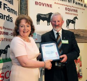 Seamus Aherne receiving the 2016 Simmental Hall of Fame Award from Mairead Lavery, IFJ