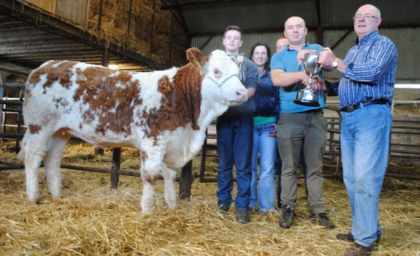 Declan Oates seller of the top priced heifer at Ballymote pictured receiving the Arther Dillon Cup from David Dillon with purchaser Sandra Killoran